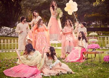 A group of friends in sorbet colors, perfect for a day mehndi