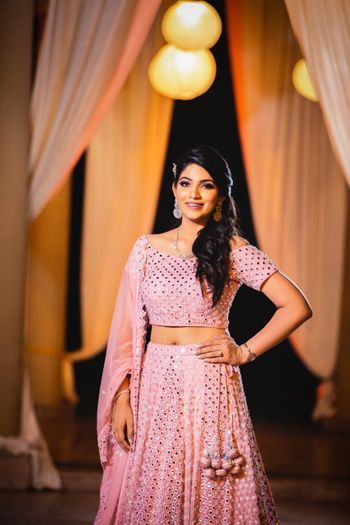 Bride in light pink sequin lehenga for engagement