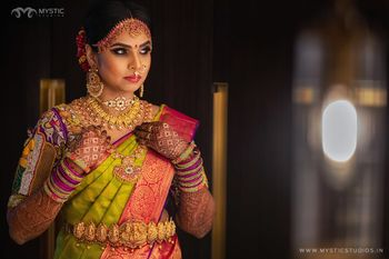 South indian bridal look with gold waistbelt and necklaces