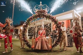 Unique grand bridal entry on an arch