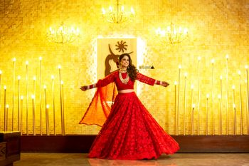 Bride dancing on reception in red lehenga