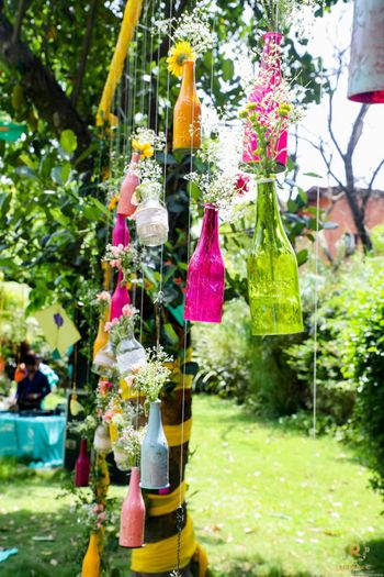 Hanging glass bottle decor idea for mehndi