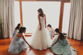 A christian bride with her bridesmaids in coordinated outfits