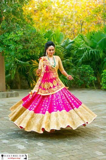 Magenta and Gold Twirling Lehenga