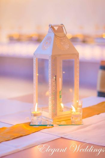 Photo of White Lanterns and Glass Candles Decor