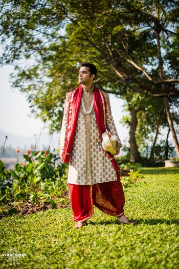 Photo of Cream and Gold Sherwani with Maroon Dupatta and Dhoti