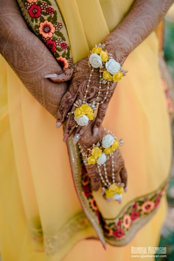 Floral jewellery with white and yellow haathphool with pearls