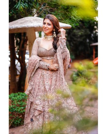 A bride to be in a lavender lehenga for her engagement