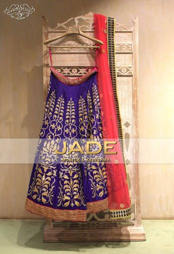 purple and gold lehenga with coral dupatta
