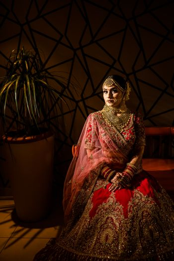 Photo of Bride in red and gold lehenga bridal portrait