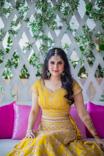 Mehendi bridal look with bride in mustard yellow lehenga