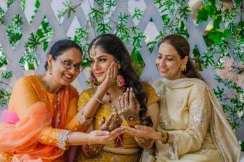 Bridal portrait with her mom and sister on mehendi