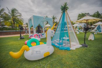 Pool party decor idea with teepee and floatie