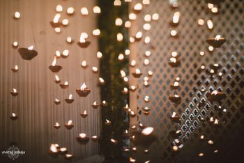Hanging tealight walll installation