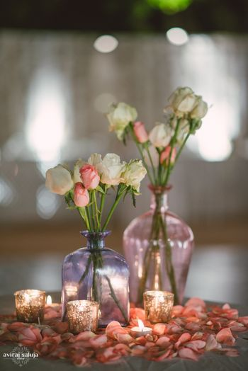 Glass Bottles with Roses Decor and Candles