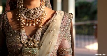 Layered bridal necklace and embroidered sleeves