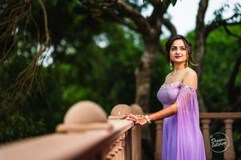 Engagement outfit with off shoulder and lavender cape sleeves