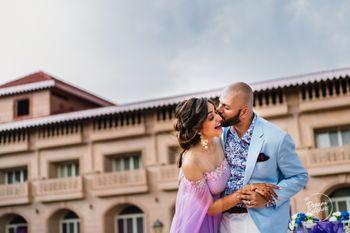 Cute groom kissing the bride on engagement shot