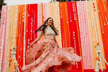 Floral print lehenga for dancing bride on mehendi