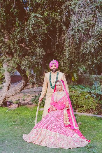 Photo of pink and gold lehenga