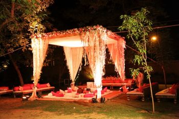 Photo of Curtain Drape Shacks with Fairy Lighting and Low Seats