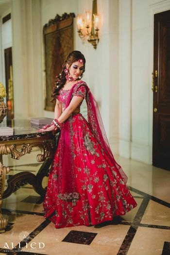 Red and pink mehendi lehenga with floral jewellery