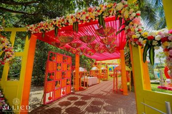 Mehendi entrance decor with hanging parasols