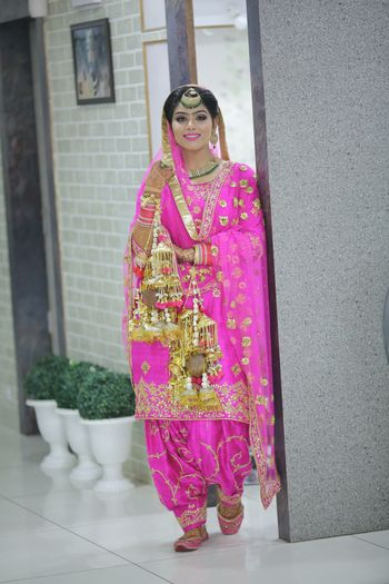 Photo of Fuchsia Pink Sikh Bride with Kaleere