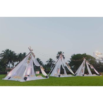 Glamping theme mehendi seating idea with tents