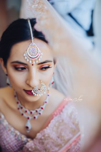 Matching bridal nath and maangtikka with ruby and diamond necklace