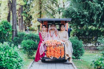 Bride making her entrance on ATV with bridesmaids