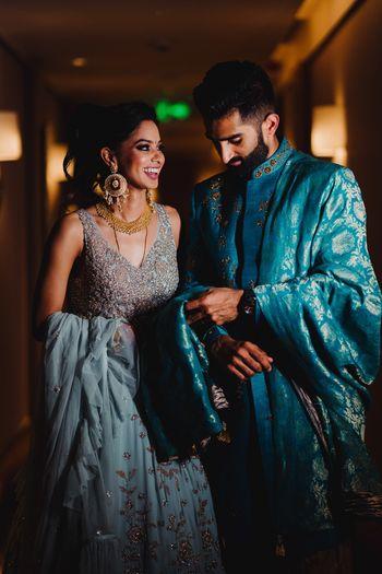 Matching bride and groom with him wearing benarasi dupatta