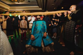 Photo of Limbo at sangeet being played by the groom