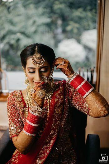 bride wearing her heavy bridal jewellery shot