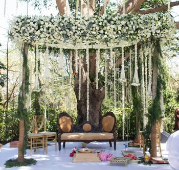 An open mandap with white floral strings