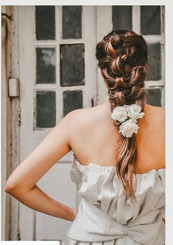 A Christian bride in a braid with roses