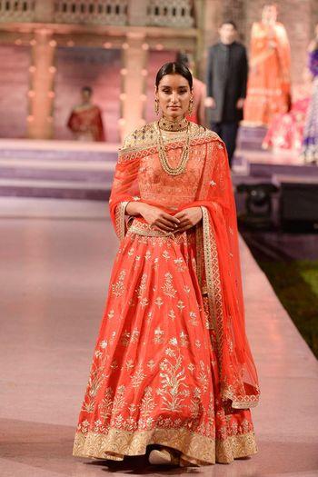 Photo of Orangey red bridal lehenga in raw silk by Anita Dongre