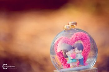 Engagement Ring on Cute Snow Globe with Couple