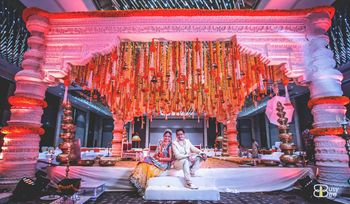 White Wedding Mandap with Genda Phool Decor