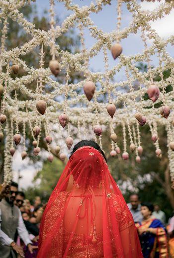 Bride under lotus phoolon ki chadar