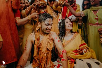 bride and groom on haldi