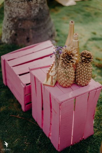 DIY gold painted pineapple centrepiece idea on crates