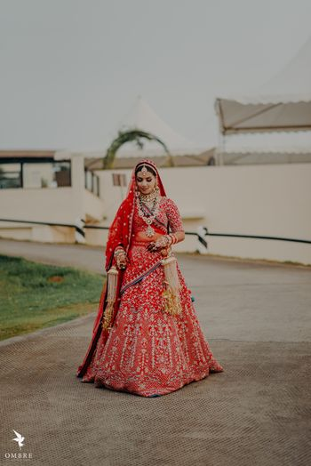 gold and red embroidered bridal lehenga with kaleere