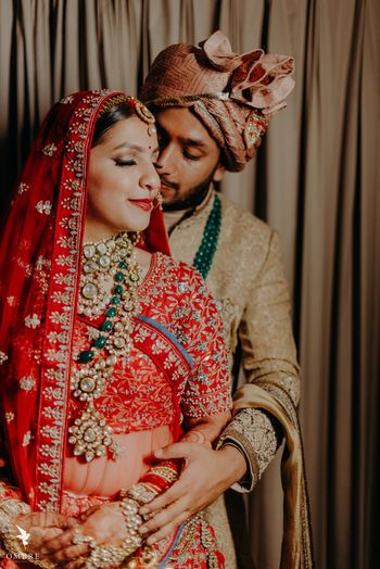 Photo of couple portrait in a romantic pose on wedding day