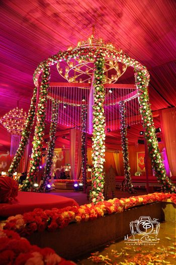 Red Themed Mandap with Floral Decor