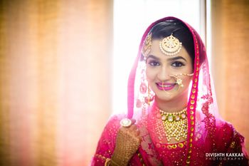 Pink Bride with Gold Choker and Maangtikka