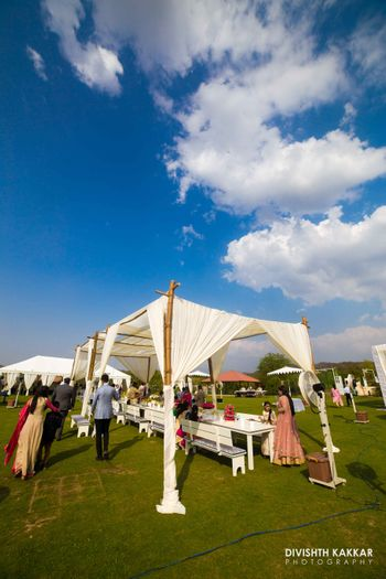 Outdoor Day Decor with White Tents and Seating