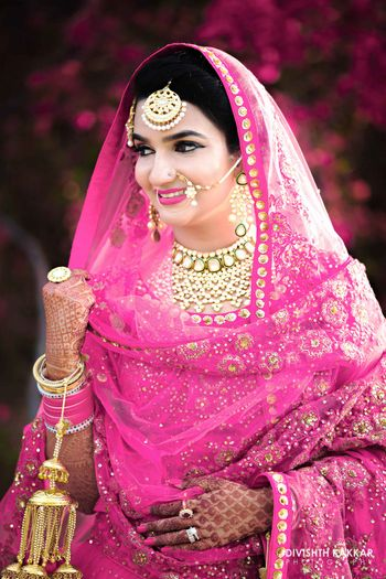 Photo of Fuchsia Pink Smiling Bride Portrait