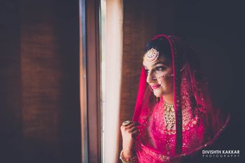 Photo of Pink Bridal Portrait with Gold Maangtikka