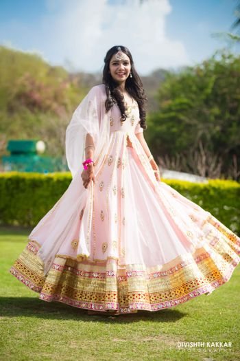Photo of Pastel Twirling Lehenga with Gold Border